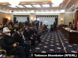 Kyrgyz lawmakers gather outside of Bishkek on October 10.