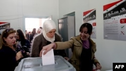 Syrian women in Damascus cast their ballots in a referendum on a new constitution on February 26.