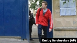 Russian opposition activist Aleksei Navalny leaves a detention center in Moscow on June 14.