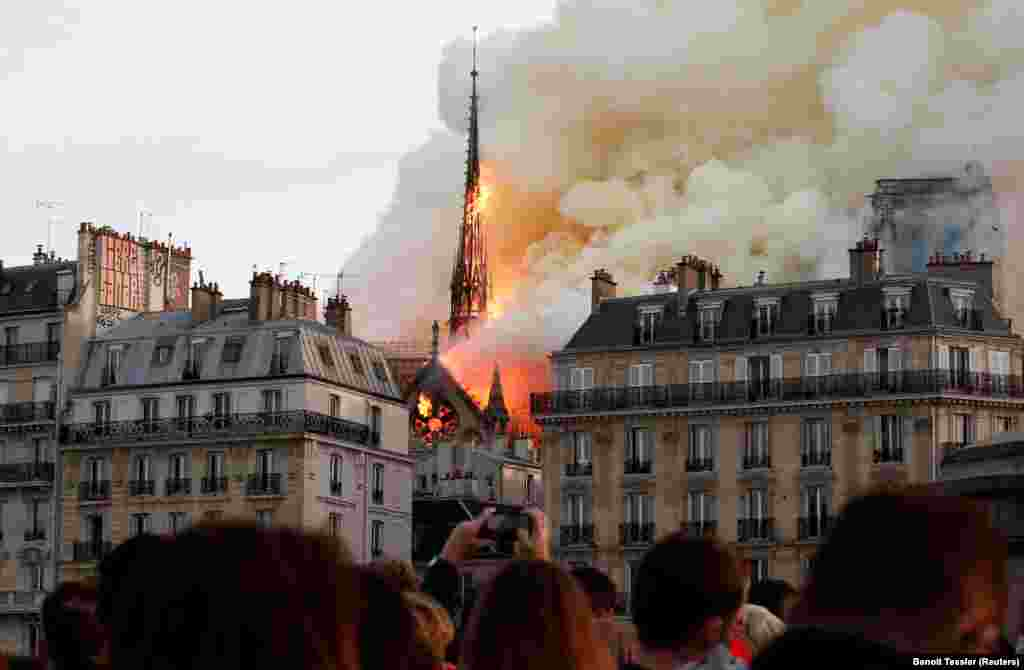 Smoke billows as fire engulfs the spire of Notre Dame Cathedral in Paris on April 15, 2019. (Reuters/Benoit Tessier)