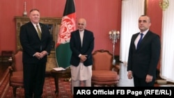 Afghan President Ashraf Ghani (C) with the U.S. Secretary of State Mike Pompeo (L) and Vice President Amrullah Saleh in the Arg presidential palace on March 23.