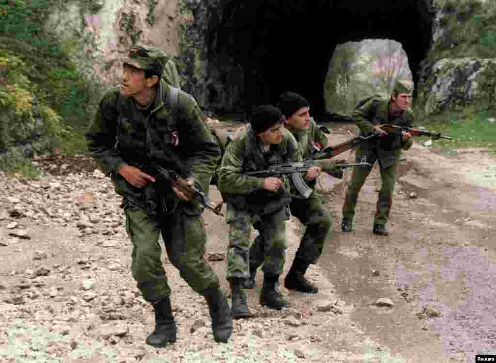Bosnian Serb soldiers patrol a mountain road to prevent Bosnian troops from breaking through to Sarajevo on April 17, 1994.
