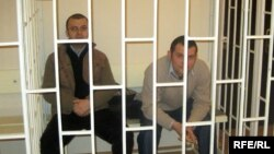 Azerbaijani authorities made abundantly clear what awaited those who aired dissenting political opinions online by jailing Emin Milli (left) and Adnan Hajizada.