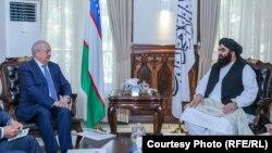 Uzbek Foreign Minister Abdulaziz Kamilov met with acting Foreign Minister Amir Khan Muttaqi in Kabul on October 7.