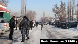 Kyrgyz authorities at the scene after the violence broke out between local residents in Uzgen and workers from China on January 9.