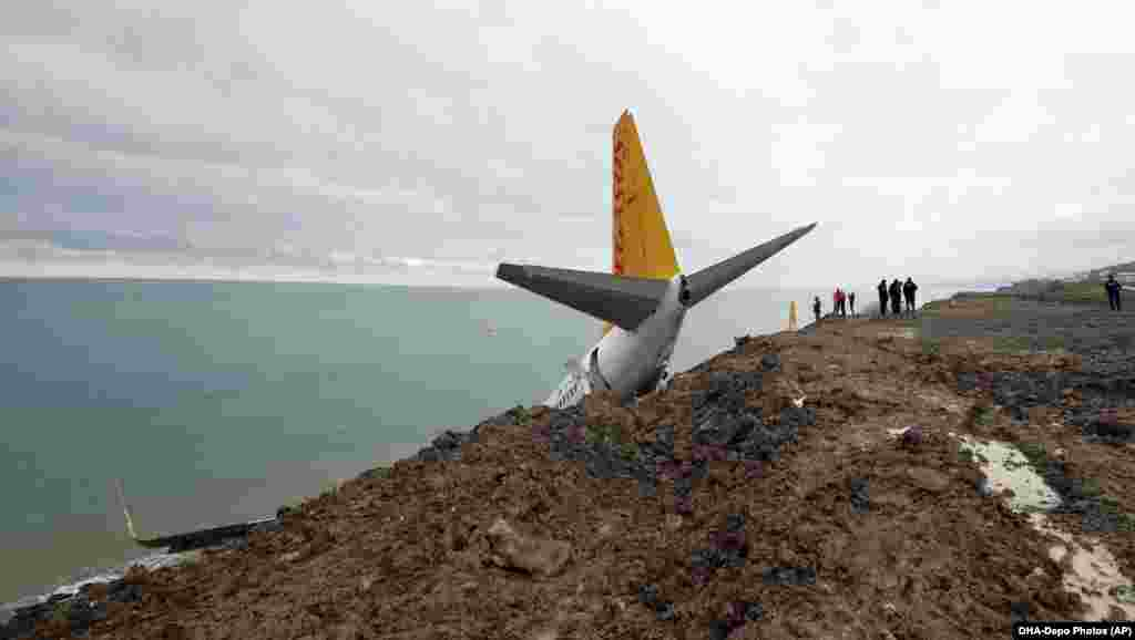 A Turkish Pegasus Airlines 737-800 that skipped off the runway in Trabzon lies stricken on the edge of a cliff on January 135. Miraculously, none of the 162 people on board was seriously injured and the plane was safely removed on January 18. (AP)