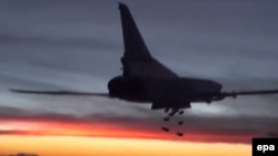 A Russian Tupolev TU-22M3 heavy bomber conducts an air strike at an unknown location in Syria late last year.