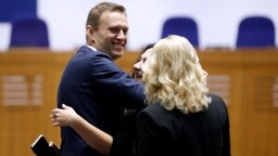 Russian opposition leader Aleksei Navalny talks to journalists after the ruling in Strasbourg on November 15.
