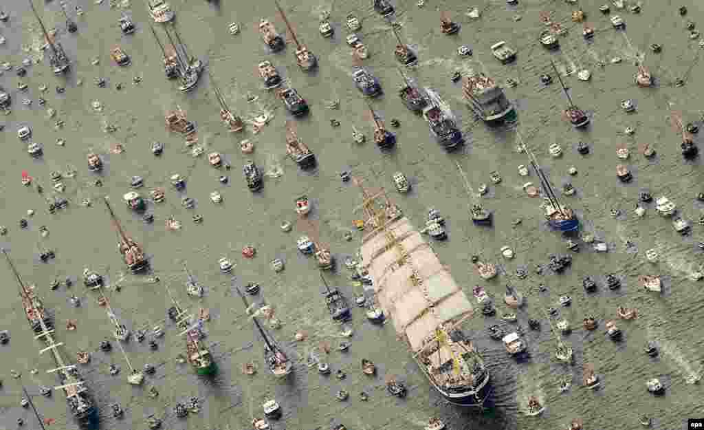 An aerial photo of the clipper ship Stad Amsterdam, accompanied by smaller vessels, as it makes its way to Amsterdam to join a flotilla of large ships. (epa/Robin Van Lonkhuijsen)