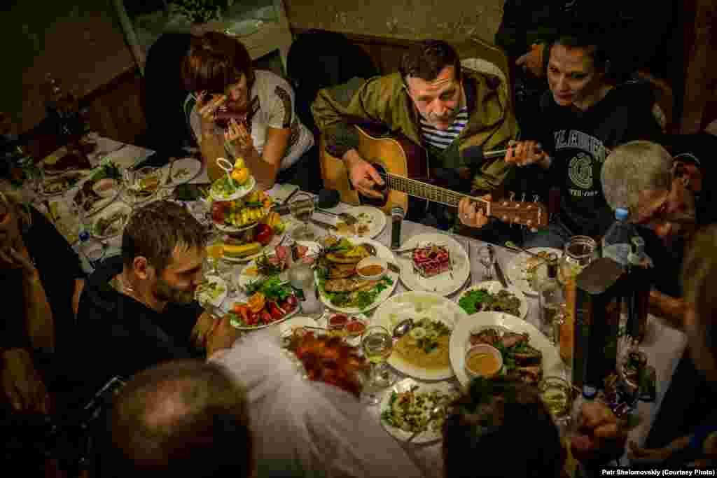 "Rebel field commander Igor Bezler, who is known to his comrades as ""Bes,"" plays guitar at the wedding of one of his unit members in Gorlovka, in the Donetsk region."
