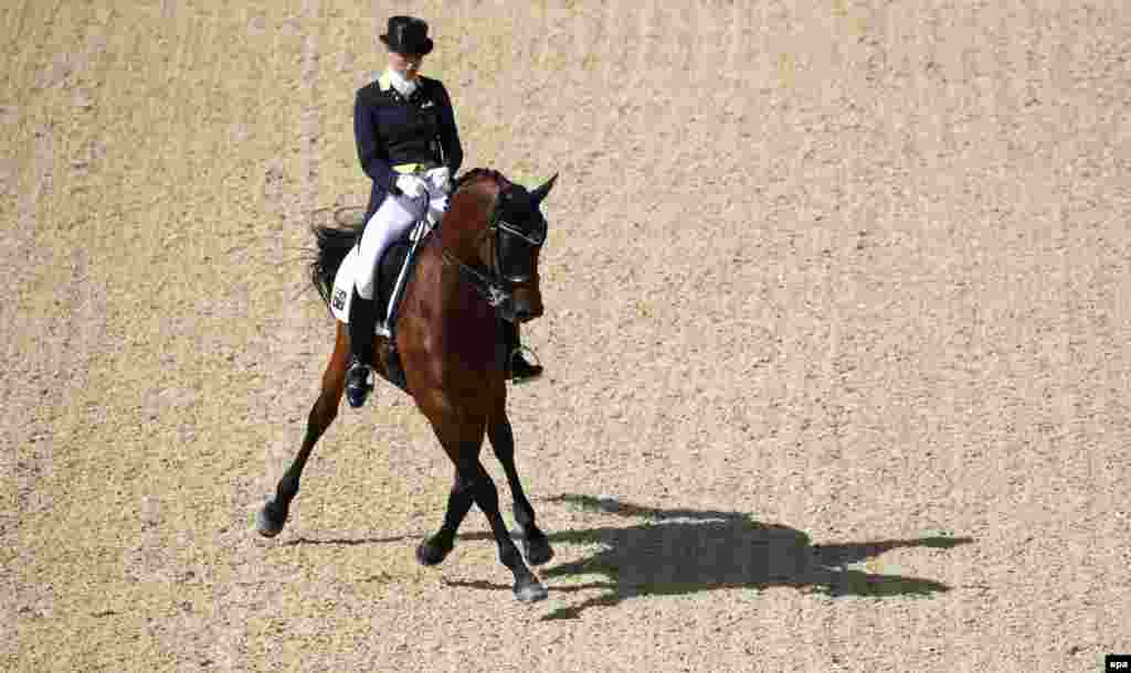 Lyndal Oatley from Australia rides Sandro Boy 9 in the dressage event.