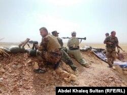 Бойцы отрядов пешмерга на севере Ирака. Сентябрь 2014 года