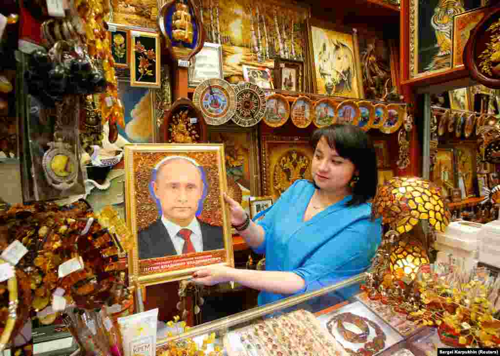 "A vendor displays an ""iconic"" portrait of Russian President Vladimir Putin at a souvenir shop in Khrabrovo International Airport outside Kaliningrad, one of the host cities for the 2018 soccer World Cup. (Reuters/Sergei Karpukhin)"