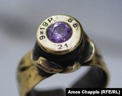 A bejeweled ring made from a 9mm pistol round