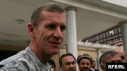 U.S. General Stanley McChrystal walks with members of the Afghan parliament in Kabul today.