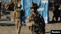 U.S. Marines patrol the market in the town of Musa Qala in the southern Helmand Province.