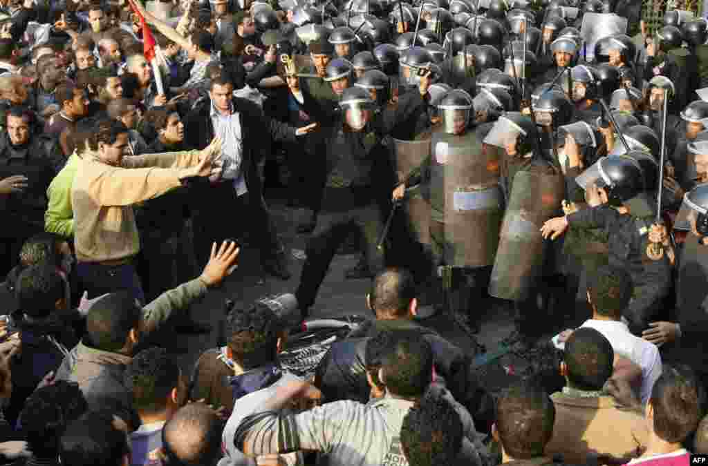 Demonstrators clash with police in central Cairo on January 25, 2011. The protesters were inspired by the uprising in Tunisia that led to the ouster of Zine El Abidine Ben Ali.