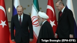 Presidents Vladimir Putin (left) of Russia, Hassan Rohani (center) of Iran, and Recep Tayyip Erdogan of Turkey are set to meet in Sochi on February 14. (file photo)