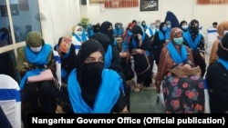 Women in Jalalabad ask the Afghan government and Taliban not to ignore women's rights during peace talks on April 27.