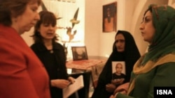Catherine Ashton (L), the European Union's top foreign policy diplomat, at a meeting with Narges Mohammadi (right), an Iranian human rights activist and mother of Sattar Beheshti, who died in Iranian custody.