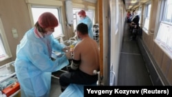 A man receives a dose of the Sputnik V vaccine in a carriage of a medical train at a railway station in the town of Tulun in the Irkutsk region on March 16. As of last week, less than 5 percent of the Russian population had been vaccinated.