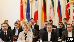 Austria -- Helga Schmid, deputy secretary-general for the external action services of EU, Iranian deputy foreign ministers Seyed Abbas Araqchi (2ndR) and Majid Takht Ravanchi (L) of Joint Comprehensive Plan of Action (JCPOA), the Joint Commission are pi