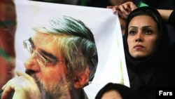 Supporters wave a poster of reformist candidate Mir Hossein Musavi. 'Yas No' had thrown its weight behind the candidate.