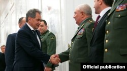 Russia - Defense Minister Sergey Shoygu (L) greets visiting top military officials from Armenia, Moscow, 17Apri2013.