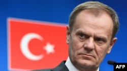 European Council President Donald Tusk addresses a press conference at the end of an EU leaders summit with Turkey centered on the migrant crisis at the European Council in Brussels on March 8.