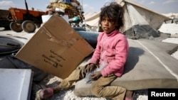 An internally displaced girl who fled Raqqa city sits inside a camp in Ain Issa, in Raqqa Governorate, on May 4.