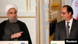 کنفرانس مطبوعاتی مشترک فرانسوا اولاند (رئیس جمهور فرانسه) با حسن روحانی در البزه در پاریس،دی ماه گذشته