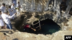 Mayan priests hold a water-blessing ceremony at the Noc Ac cenote, a natural deep deposit of water, in Yucatan, Mexico, on December 15 within the framework of a cultural festival to celebrate the end of the Mayan calendar.