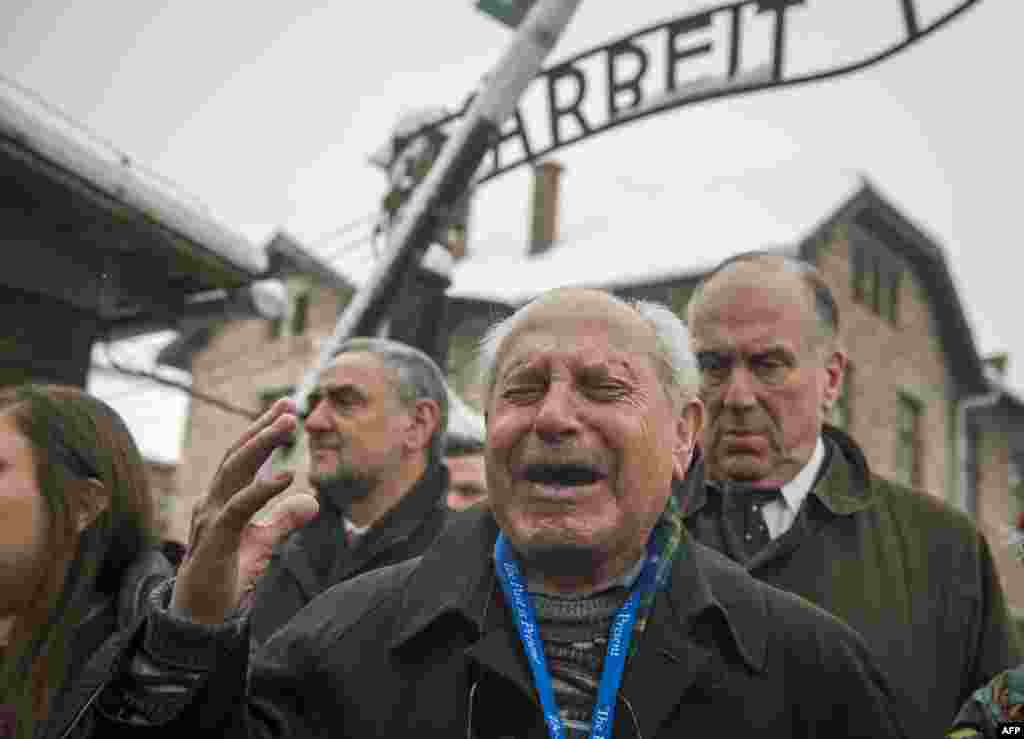 Holocaust survivor Mordechai Ronen is overcome with emotion standing next to the president of the World Jewish Congress, Ronald Lauder (right), as he arrives at the former Auschwitz concentration camp in Oswiecim, Poland, ahead of commemorations marking the 70th anniversary of its liberation.