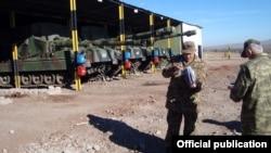 Turkey - An Armenian officer (L) inspects a Turkish military base near Kars, 28Nov2012.
