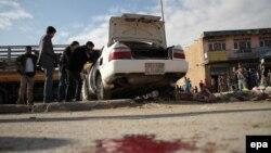 Кобулда амалга оширилган бомбали ҳужумдан сўнг олинган сурат, 2014 йилнинг 14 октябри.
