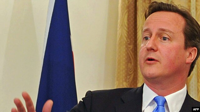 British Prime Minister David Cameron speaks at a news conference in Kabul on June 10.