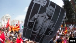 Protestors hold a portrait of Macedonian Prime Minister Nikola Gruevski, depicted behind bars, during an antigovernment rally in Skopje earlier this year. The country has seen months of political turmoil following wiretapping allegations against the premier.