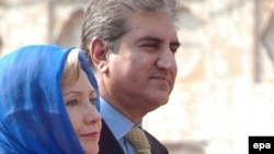 Pakistani Foreign Minister Shah Mehmood Qureshi with his U.S. counterpart, Hillary Clinton, during Clinton's visit to Lahore on October 29.