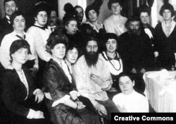 Grigory Rasputin (fourth from left, front row) surrounded by admirers. With his infamous appetite for sex, Rasputin reveled in the attention of society ladies when he wasn't chasing prostitutes in St. Petersburg/Petrograd (date unknown).