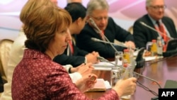 EU foreign policy chief Catherine Ashton (foreground) takes part in talks on Iran's nuclear program in Almaty on April 5.