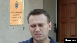Aleksei Navalny speaks to the media outside the Federal Investigation Commission building in Moscow on June 13.