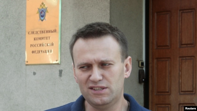 Aleksei Navalny speaks to the media outside the Federal Investigation Commission building in Moscow in June.
