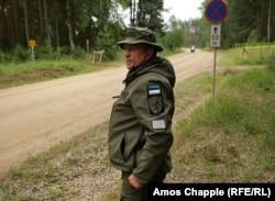 Estonian border guard Viktor Kullasaar monitors traffic through the meters-long stretch of Russian territory.