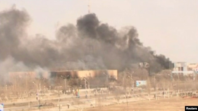 Clouds of smoke rise from the Kazakh town of Zhanaozen in December 2011 in a still image taken from video acquired by Reuters TV.