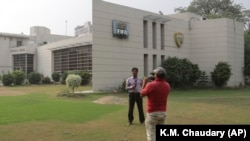 A local news channel crew filming outside the FIFA office in Lahore. (file photo)