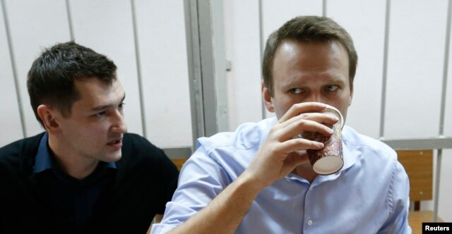 Aleksei Navalny (right) and his brother and co-defendant Oleg attend a court hearing in Moscow on December 19.