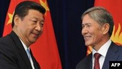 Президент Алмазбек Атамбаев Кытай төрагасы Си Цзинпин менен. Бишкек, 11-сентябрь, 2013