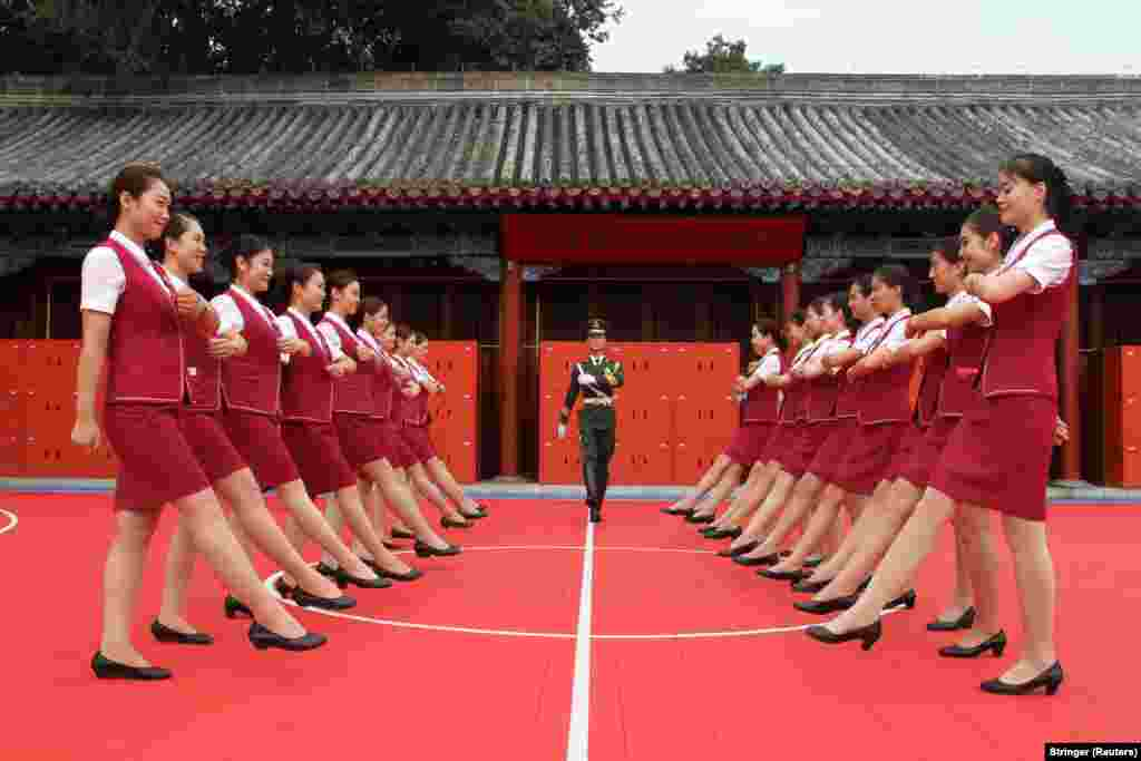 Train attendants take part in training ahead of celebrations marking the 90th anniversary of the founding of the Chinese People's Liberation Army (PLA) in Beijing. (Reuters/Stringer)