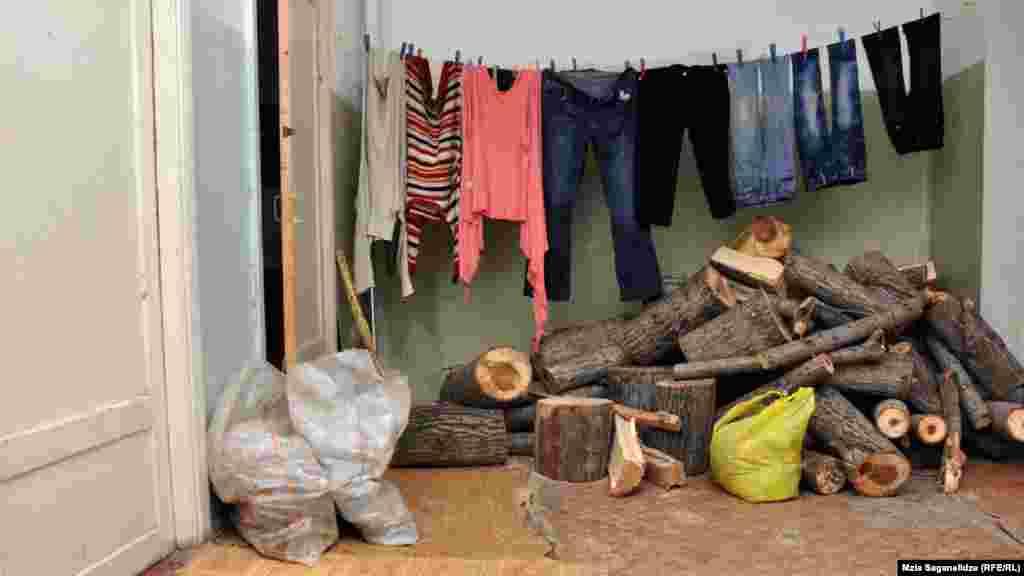 Residents keep a store of firewood for heating during the cold winter weather.