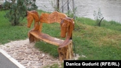 Self-taught sculptor Golub Milanovic carves wooden benches